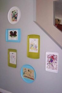 kids' art mounted on trays for art wall