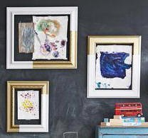 art taped to wall in open frames without glass or backs