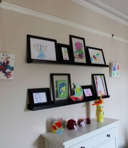 display kids' art on picture ledges