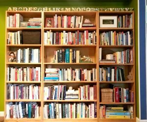 curated shelves of books and art