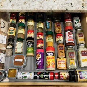 Kitchen drawer filled with spice bottles