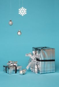 Gift boxes wrapped in silver paper
