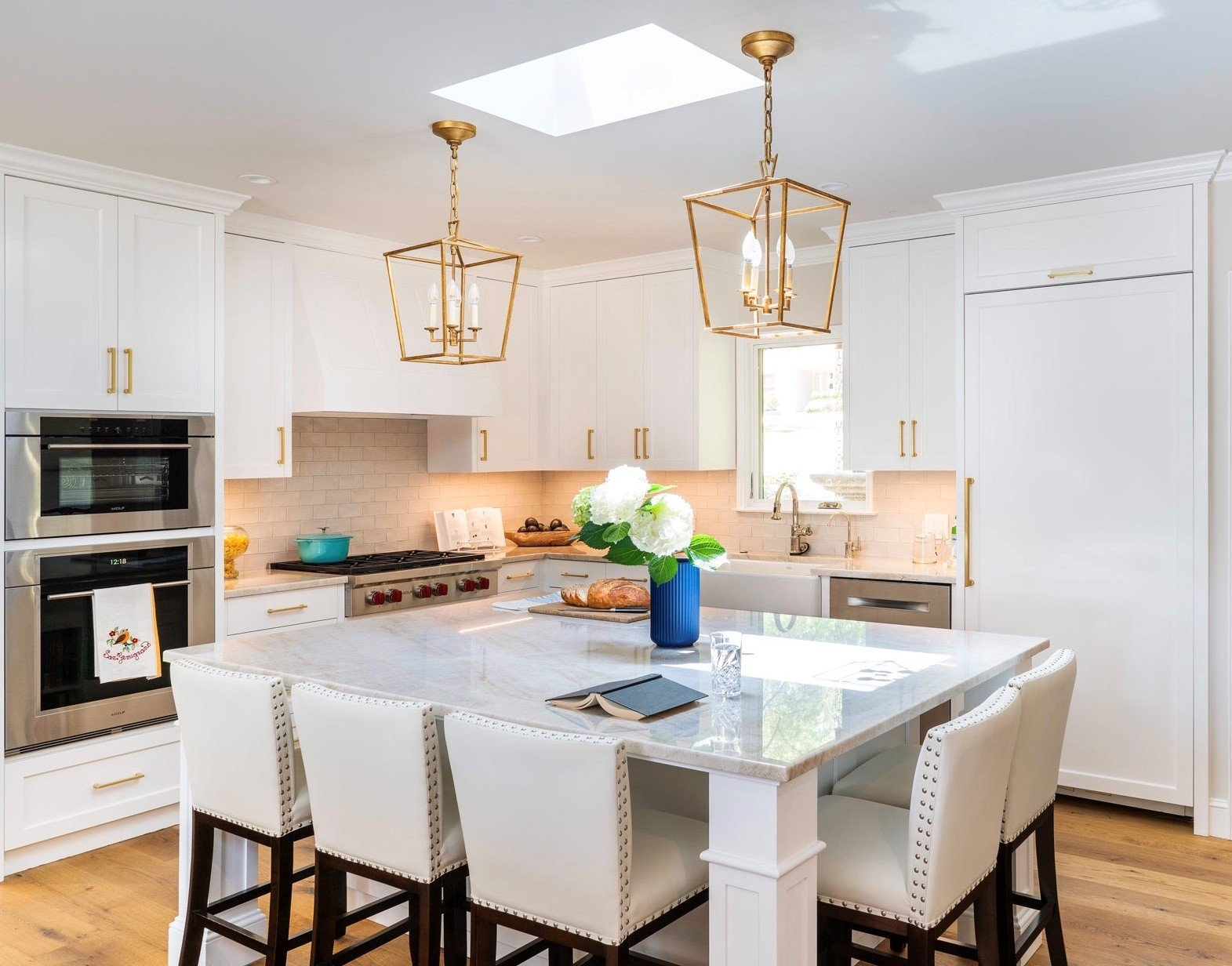 Kitchen island with clean counters and organized spaces.